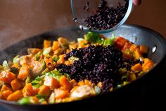 To this colorful winter hash I've added cooked black rice, which contributes a chewy texture and an earthy flavor that plays well against the sweetness of the squash and the seared brussels sprouts.