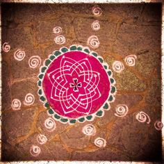 Rangoli Pattern found outside a restaurant during Diwali in the Pune.  These patterns are made of coloured sand and used to welcome Laxmi into their homes/businesses.