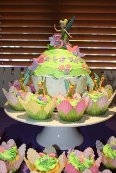 Tinkerbell cupcakes and cake by PaintedSugar, via Flickr