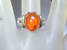 Bezel Oval Cabochon Orange Spessartite Garnet Solitaire Ring Sterling Silver & 18kt Gold by Gemsbygigialonia on Etsy #sold