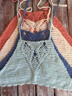 Our hand crochet halter top is made from 100% cotton, with all natural fabric dyes, and has string ties for an adjustable fit. It's perfect paired with cut offs, a maxi skirt, or even as a swimsuit to