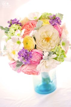 DK Designs - vintage inspired bouquet: dogwood, ranunculus, heirloom and garden roses, hydrangeas, purple stock flower, lily of the valley, dusty miller leaves and gardenias