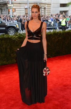 Jessica Hart showed some skin in a black leather cutout crop top and a sheer black maxi skirt. #MetGala