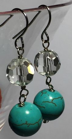 Beautiful blue magnesite and clear crystal bead nickel and lead free fashion earrings. The 11mm dyed magnesite and 7mm faceted clear crystal beads are set on french wire earrings. The earrings hang a