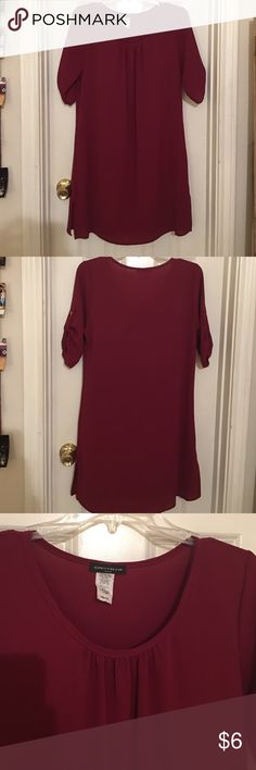 Maroon Short-Sleeve Dress Light material, tag does not state what type of material - is semi-stretchy and might require a slip. Worn once, great condition. Cantata Dresses