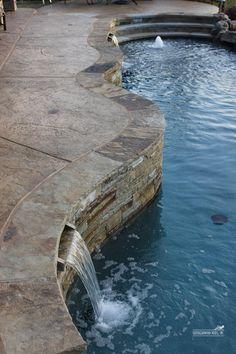 stamped concrete/ natural stone edge