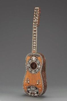 1725 Italian Guitar (chitarra battente) at the Museum of Fine Arts, Boston - This is a stunningly beautiful piece. And it must have been expensive, too - the inlay is made of mother-of-pearl, ivory and tortoiseshell.