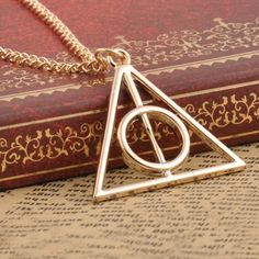 Harry Potter Deathly Hallows Pendant Necklace. Order Now! Just pay $0.50 plus shipping.