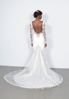 in love with this lace sleeve, backless wedding dress