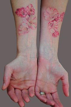 delicate flower tattoos - could be a good tattoo too for placement in a visible area as its feminine and soft :)