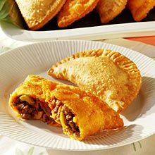 My favorite Puerto Rican food is Pastelillos or what Mexicans refer to as Empanadas or Americans as meat pies.  I'll add a few photos of my home made ones too. I make my own sofrito and freeze it in ice-cube trays for seasoning in several recipes.