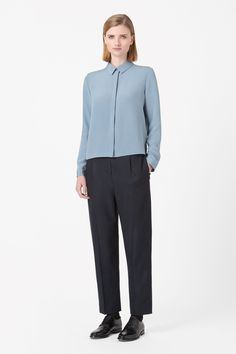 Designed to fall loosely on the body, this straight-cut shirt is made from smooth, lightweight silk. A long-sleeved style with button cuffs, it has a narrow pointed collar, straight hemline and hidden buttons for a clean front.