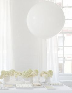 White tablescape with oversized balloon