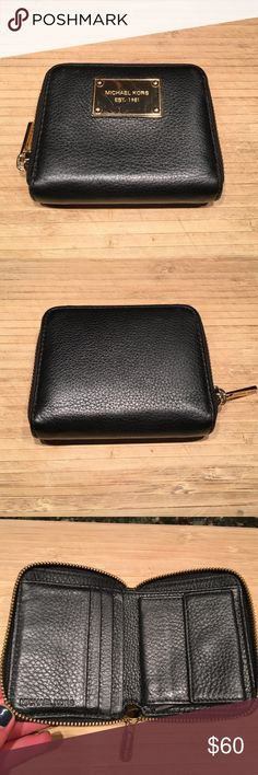 "Pebbled Leather Jet Set Zip Around Bifold Wallet Leather Imported Zip closure Soft black full grain pebbled leather with polished gold tone hardware Zip around style with MK nameplate on the front Leather and MK logo nylon interior features 4 credit card slots and a billfold compartment Interior also features a snapped coin compartment and a slip compartment Measures approximately 4"" (L) x 3.5"" (H) x 1"" (W) Michael Kors Bags Wallets"