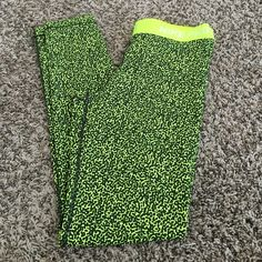 Nike full length spandex New without the tags. Never been worn before or washed. Size L, full ankle length spandex. Neon yellow and black in color. (See pictures) Nike Pants