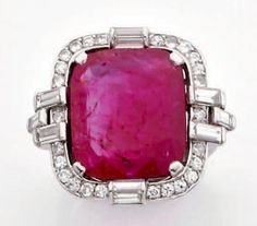Ring in platinum set with a large ruby in a surround of brilliant-cut diamonds and baguette. Hallmark Charles Holl who worked for Cartier.