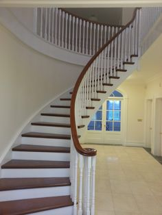 Curved Stairs with Mahogany Treads and handrail.