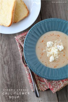 This Cheesy Cauliflower Soup is so creamy and delicious and good for you too! You won't believe how tasty this simple soup is! LoveGrowsWild...
