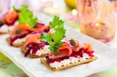 Canapes with salmon and beetroot