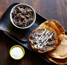 Tostadas with Mashed Black Beans: In a 2-quart saucepan over medium heat, combine the beans, olive oil, onion and garlic powders, chipotle, oregano, and 1/4 cup water. Cook, mashing with a potato masher, until the beans are hot, well mashed, and thickened to a spreadable consistency, about 3 minutes. Season to taste with salt. Oven 400F-Coat tortillas w/oil, bake 5 min, flip, bake another 2-3min.