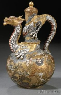 A Satsuma wine ewer, dragon spout and handle, design of the Hundred Buddhist Saints, Japan, circa 1876-1900