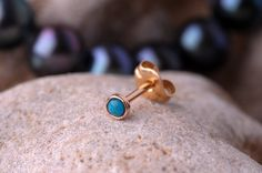 TRAGUS STUD 2mm turquoise stone  in 3mm 14K yellow gold filled setting. Also nose or Ear Stud handcrafted. $14.00, via Etsy.