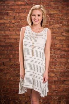 Easy Fix Tank Dress, Ivory || It doesn't get any better than comfy cute tank dress! Take this one for example. It's clearly super comfy and generously cut! It's also so easy to style! With it's ivory fabric and black stripes you can just about wear any color necklace and shoes you'd like! Plus, we do love when sweet dressed like this have a little pocket!