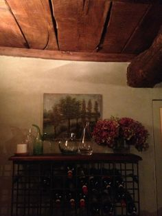 We had the iron racks made by a local blackmith and topped them with old wood. The chestnut-plank ceiling is original to the house, and the painting of Saint Francis and the Wolf, recalls that the house was built by his followers in the 1200′s. Frances