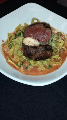 oz. grilled beef tenderloin filet over a nest of house-made ...