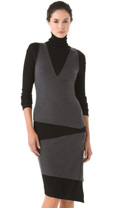 Donna Karan A cozy,Casual Luxe Two Tone Turtleneck    This sophisticated wool top is constructed of a contrast V-neck tank layered over a soft ribbed tee, with a slouchy turtleneck adding extra warmth. Uneven hem. Long sleeves. Worn with Donna Karan Casual Luxe Two Tone Skirt, effortless approach to a put-together look.