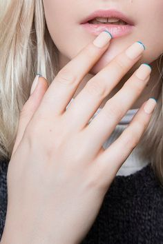 Try these easy-to-master minimal nail art designs from @Stylecaster | clear french manicure with blue tips