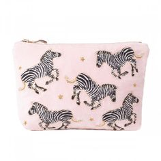 Gallop in to a new day feeling tropical and fresh with this Elizabeth Scarlett Zebra Rosewater Velvet Makeup Bag. Inspired by her travels, this hand-drawn zebra illustration is embroidered using golden threads on to this elegant pink velvet fabric. Cotton Velvet, Pink Velvet, Zebra Illustration, Makeup Brush Case, Animal Makeup, Pink Animals, White Zebra, Wash Bags, Rose Water