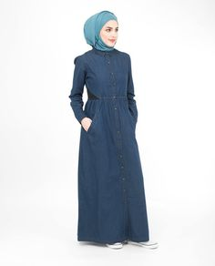 A popular denim number tweaked for you sisters who can't get enough of our cool denim designs. A beautifully gathered Jilbab in soft fine denim with simple details for any season. Your must have wardrobe essential. Denim Abaya, Abaya Designs, Islamic Clothing, Abayas, Casual Wear, Sisters, High Neck Dress, Number, Gowns