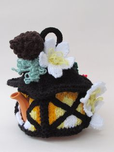 The Christmas Lantern tea cosy from the TeaCosyFolk range of tea cosies has bags…
