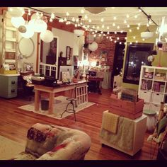 Love this office belonging to Kelly Rae Roberts, artist. Cool use of architectural salvage pieces, lighting, and space.