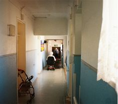 nerve #film #35mm #expired #kodak #grain #analogue #southafrica #exploration #zen #Ishootfilm #buyfilmnotmegapixels #melancholy #hallway #wheelchair #old #people #curtain #natural #oldage #home #blue