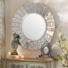 The Antiqued Silver Fin Wall Mirror shines with originality and style! This circular wall mirror features unique fin-shaped panels in an antiqued mirror finish. #kirklands #SweeetSimplicity