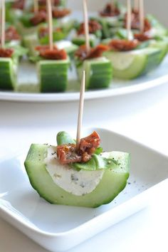 The best smoked salmon cucumber appetizers. Thinly sliced cucumber rolled up with smoked salmon cream cheese spread inside.