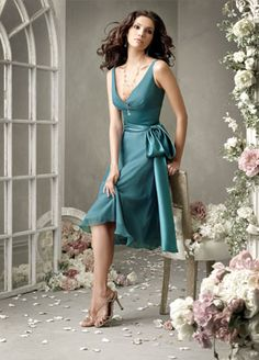 Teal chiffon. Jim Hjelm. A little higher on the teal spectrum and very flattering for everyone.