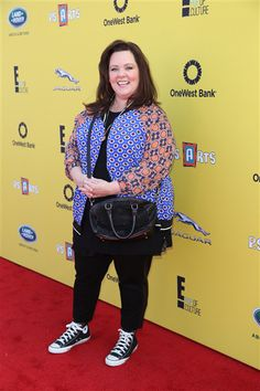 When Melissa McCarthy stepped out at the P.S. ARTS Express Yourself Event 2014 in Los Angeles, she looked cheerful and noticeably thinner. But we would have picked a different look for the debut of our new bod. The lightweight coat is too cute, but the super casual high-top Chucks don't flow with the rest of the 'fit.