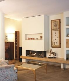 The Exquisite Corner Fireplace Ideas : Modern Living Room With Cool Corner Fireplace Gas Also Modern Mantel Style Also Small Horse Chair Ornament Also Modern And Simple Coffee Table With Glass Countertop Also Floral Fabric Armchair Also Brown Flooring
