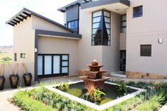 Gorgeous, quaint, picturesque - this magnificently modern home is beautifully nestled in the gem that is the Eye of Africa.   HomesInJohannesburg #PropertyForSale #JHB #Gauteng #ResidentialEstates