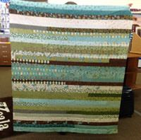 Jelly Roll Quilt Idea! {To do with the greens, blues, and browns that I have set aside in a Queen Size quilt}