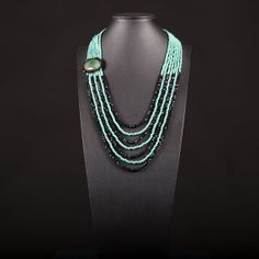 Necklace with 7 strands of turquoise 4 strands black by Menir, €65.00