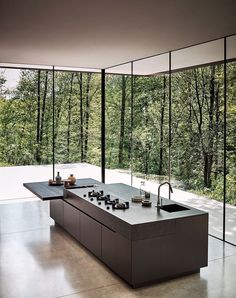 Minimal black kitchen island bench surrounded by tall windows with natural light. - Minimal black kitchen island bench surrounded by tall windows with natural light Modern home House design Source by -