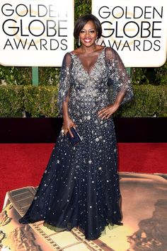 Viola Davis twinkled in a tulle ball gown with a plunging illusion neckline and flutter sleeves. See more of the Golden Globes' best dressed stars here!