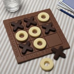 Noughts and Crosses Game  - The best game, everyone knows the rules and in this case, surely the winner eats all! Great for parties, after dinner or just a rainy afternoon.  Handmade from Milk, Dark and White Belgian chocolate. Beautifully presented in a gift box. Size 20 x 20 cm Shelf life 1 year