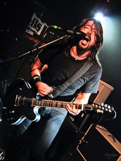 Dave Grohl of The Foo Fighters succeeding Nirvana. One of the most awesome, hardest rocking guys in music.