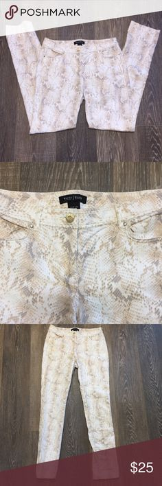 White House Black Market Snake Print Slim Leg Jean Gently used pair of snake print jeans. There is a black mark on the right pocket, but these are still a really pretty pair of jeans. The material is a stretchy jegging material. White House Black Market Jeans Skinny