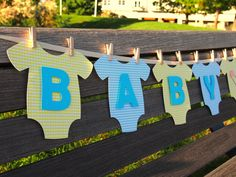 "Onesie ""BABY BOY"" Baby Shower Banner: Yellow and Blue Baby Shower Decoration. $31.95, via Etsy."